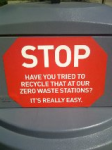 Stop signs on the garbage bins